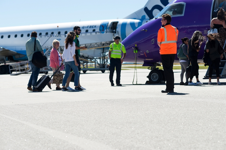 Cornwall-Airport-Newquay-Passengers-Boarding-Flybe-Purple-Plane