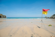 Cornwall-St-Agnes-Beach-Lifeguard-Flag-Adam-Gibbard